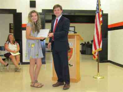 Kiwanis Club Adivisor Mitch Broyles presented the T.A. Dugger Builders Club Charter to the club's first president, Izzy McQueen.