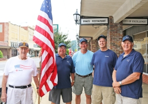 Kiwanis Club members (from left) Jim Wilson, Danny Smith, Tim Broyles, David LeVeau, and Bill Kyte are some of the members who distribute flags on national holidays throughout Elizabethton.